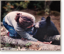 Rae with black bear cub she rescued from hunters